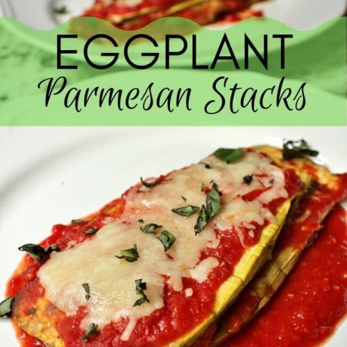 Two white plates, each with a stack of eggplant with layers of tomato sauce and cheese