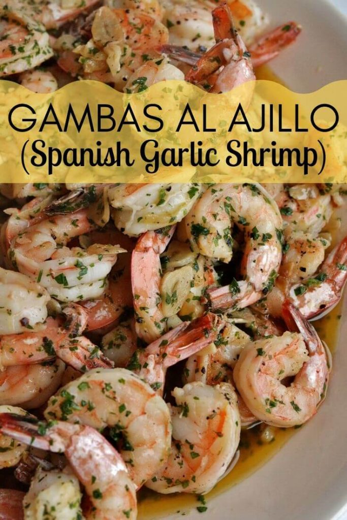 A platter of Spanish garlic shrimp with sliced garlic and parsley