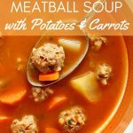 closeup of meatball soup with potatoes and carrots in a bowl