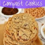 close up of compost cookies stacked high on parchment paper