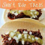 close up of braised short rib tacos in corn tortillas