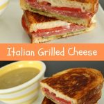 A close up of an Italian grilled cheese sandwich and a cup of soup