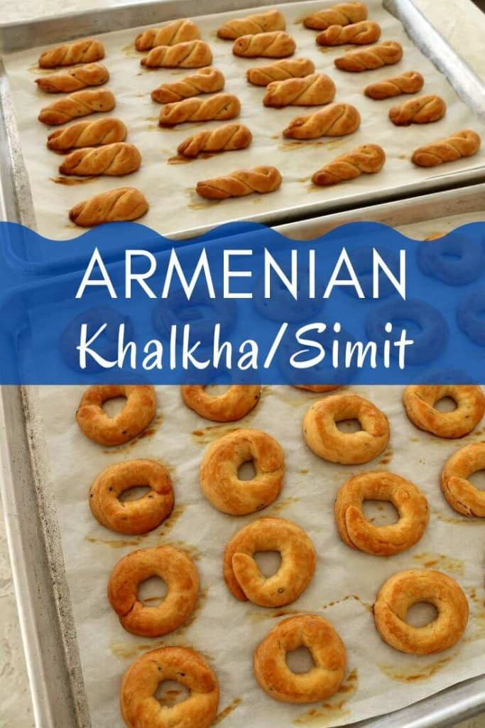 Two trays of baked Armenian khalkha / simit, half shaped into rings, the other into twists
