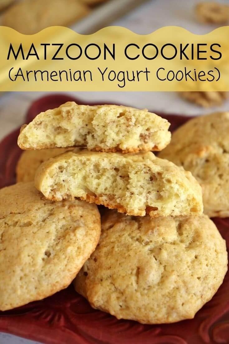 a plate of Armenian yogurt cookies with one broken in half