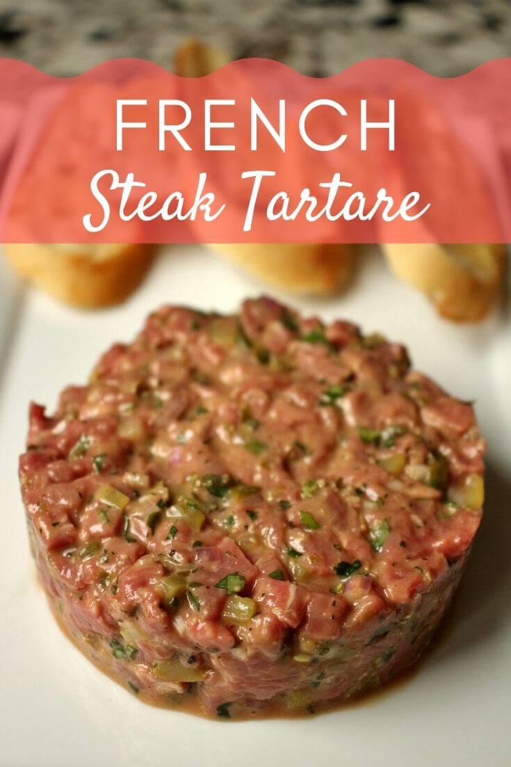 French steak tartare served on a white rectangular plate