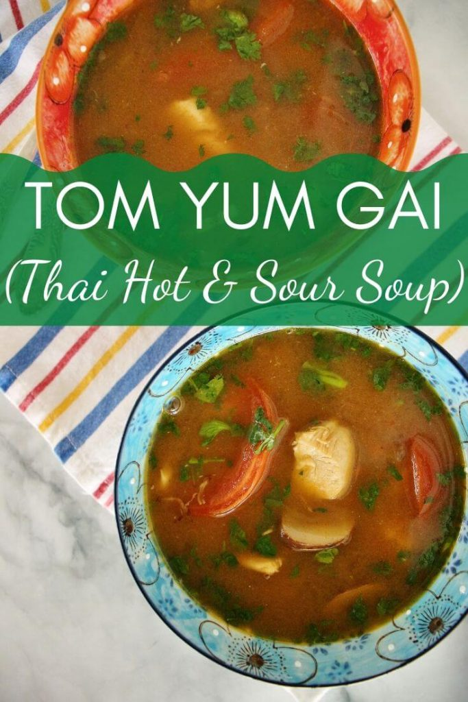 2 servings of tom yum gai (hot and sour chicken soup) in colorful floral bowls