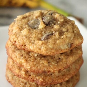 a stack of banana chocolate chip cookies on a white plate