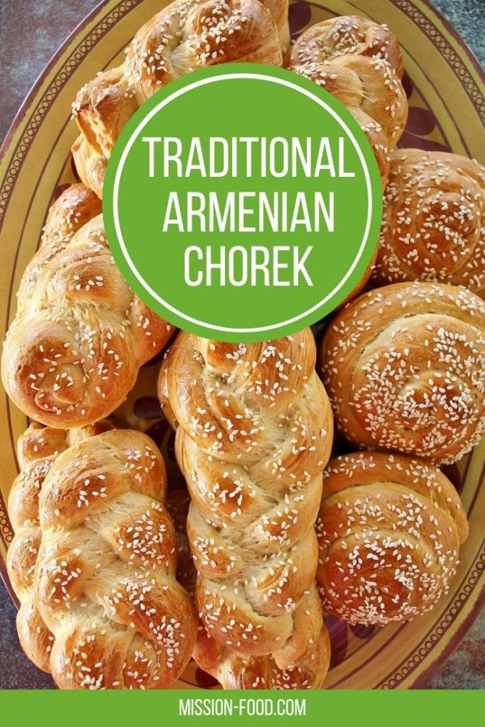 A platter of chorek (Armenian sweet bread) with a combination of braids and snail shapes, all topped with sesame seeds