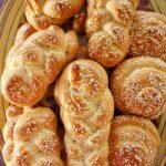 a large platter of Armenian chorek sweet bread with sesame seeds