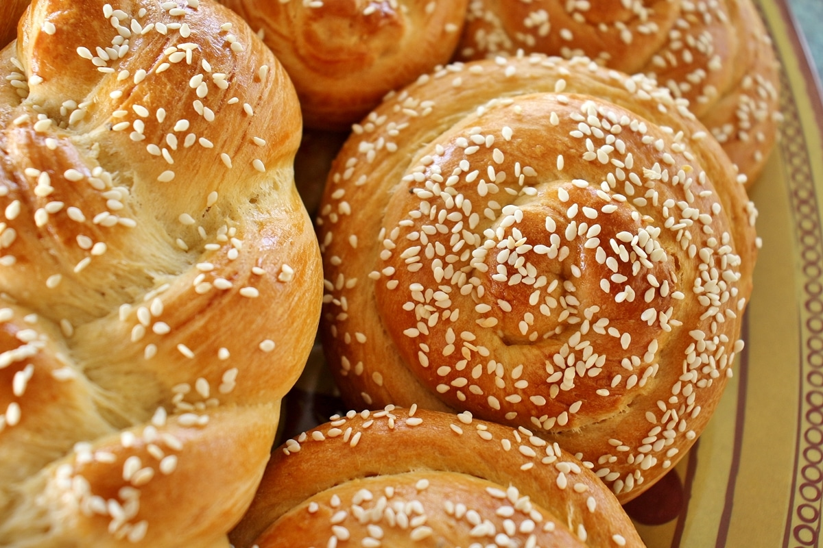 Closeup of spiral-shaped Armenian sweet bread (chorek) topped with sesame seeds