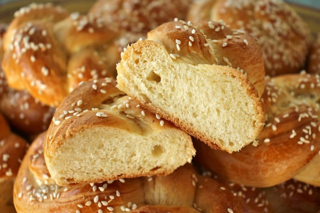 Close up of a chorek (Armenian sweet bread) cut in half to show a cross-section of the interior