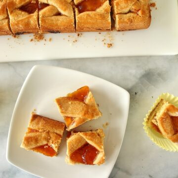 squares of Russian apricot pirog served on a marble countertop