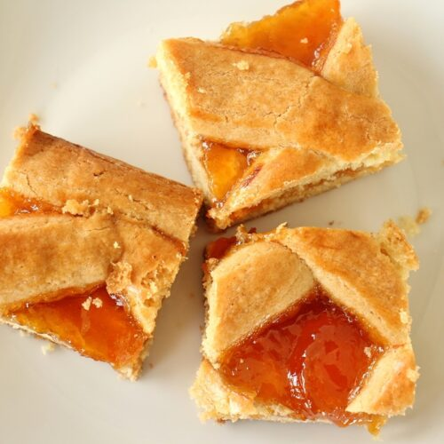 3 squares of apricot pirog on a white plate