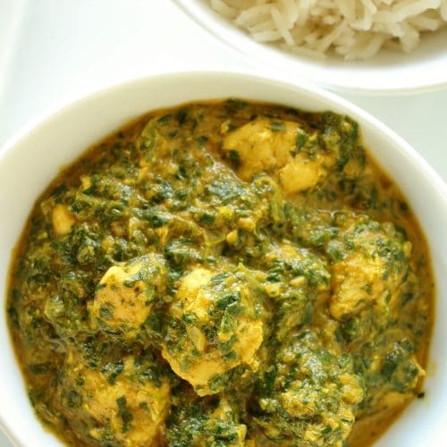 closeup of chicken saag in a small white bowl