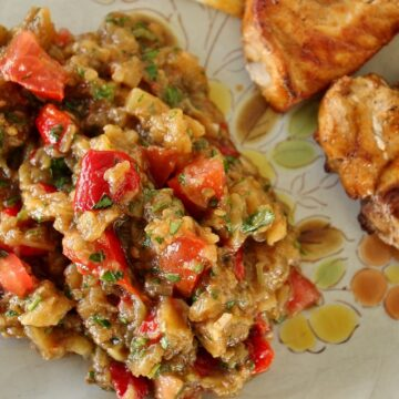 grilled vegetable salad on antique plate with pork chops