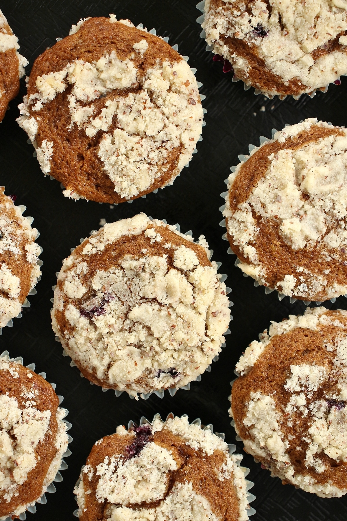 Bouchon Bakery blueberry muffins with streusel topping on a black surface