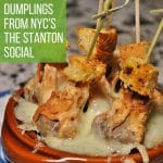 French onion soup dumplings in an escargots dish with croutons skewered on top