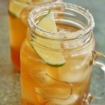 2 tamarind margaritas in mason jar mugs