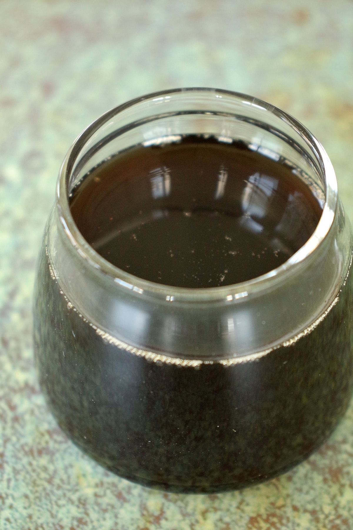 Homemade tamarind simple syrup served in a tiny jar