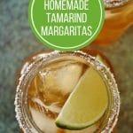 Overhead closeup of 2 tamarind margaritas in mason jar mugs