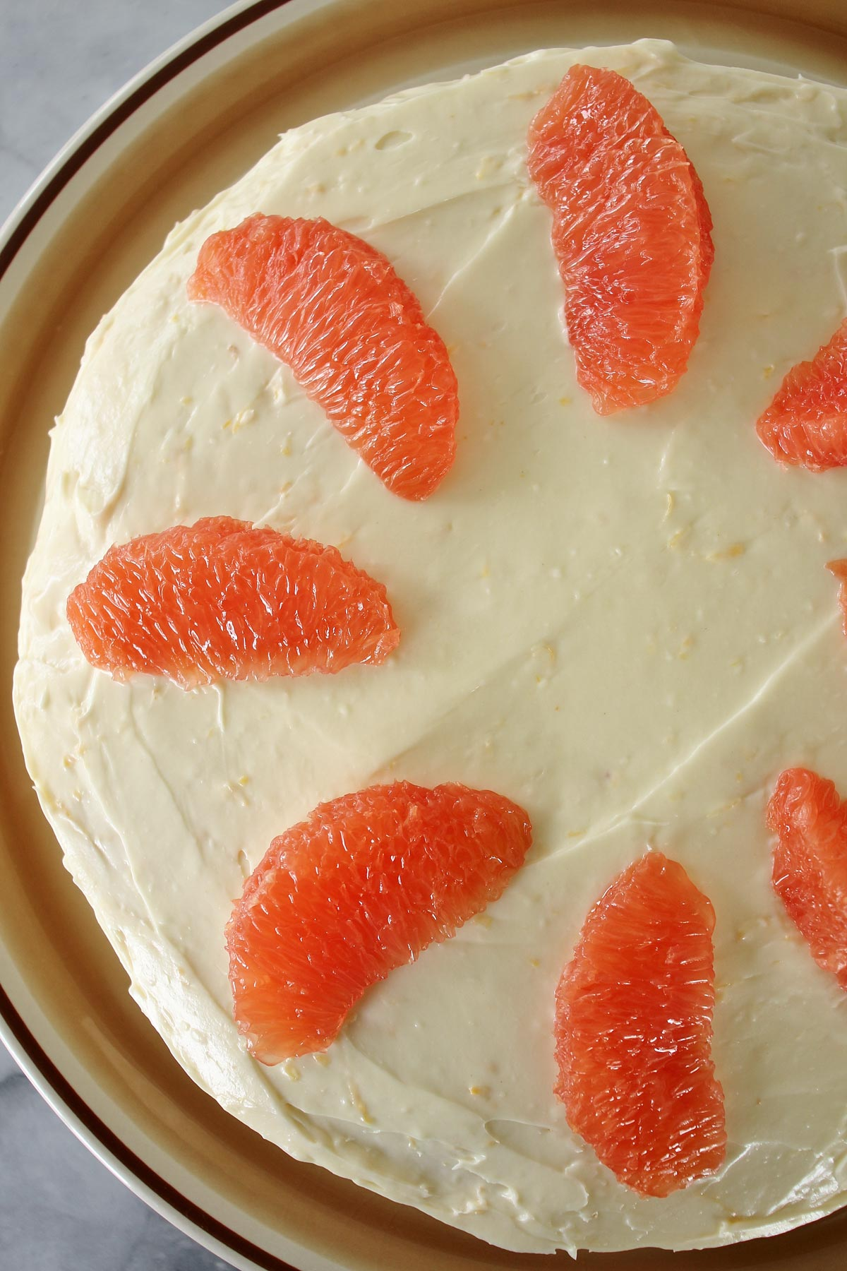 Overhead view of retro Brown Derby Grapefruit cake, with grapefruit segments decorating the top