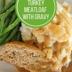 overhead view of turkey meatloaf with onion gravy, mashed potatoes and green beans