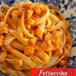 a shallow bowl of fettuccine with chicken sauce