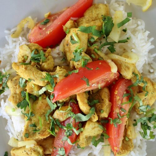 home-style chicken kebat stir-fry served on a square plate with rice