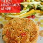 a golden brown lobster cake served with colorful slaw