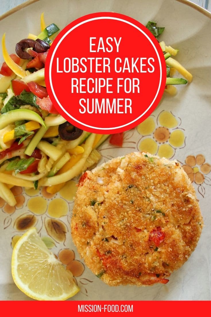 overhead view of a lobster cake served with a lemon wedge and slaw