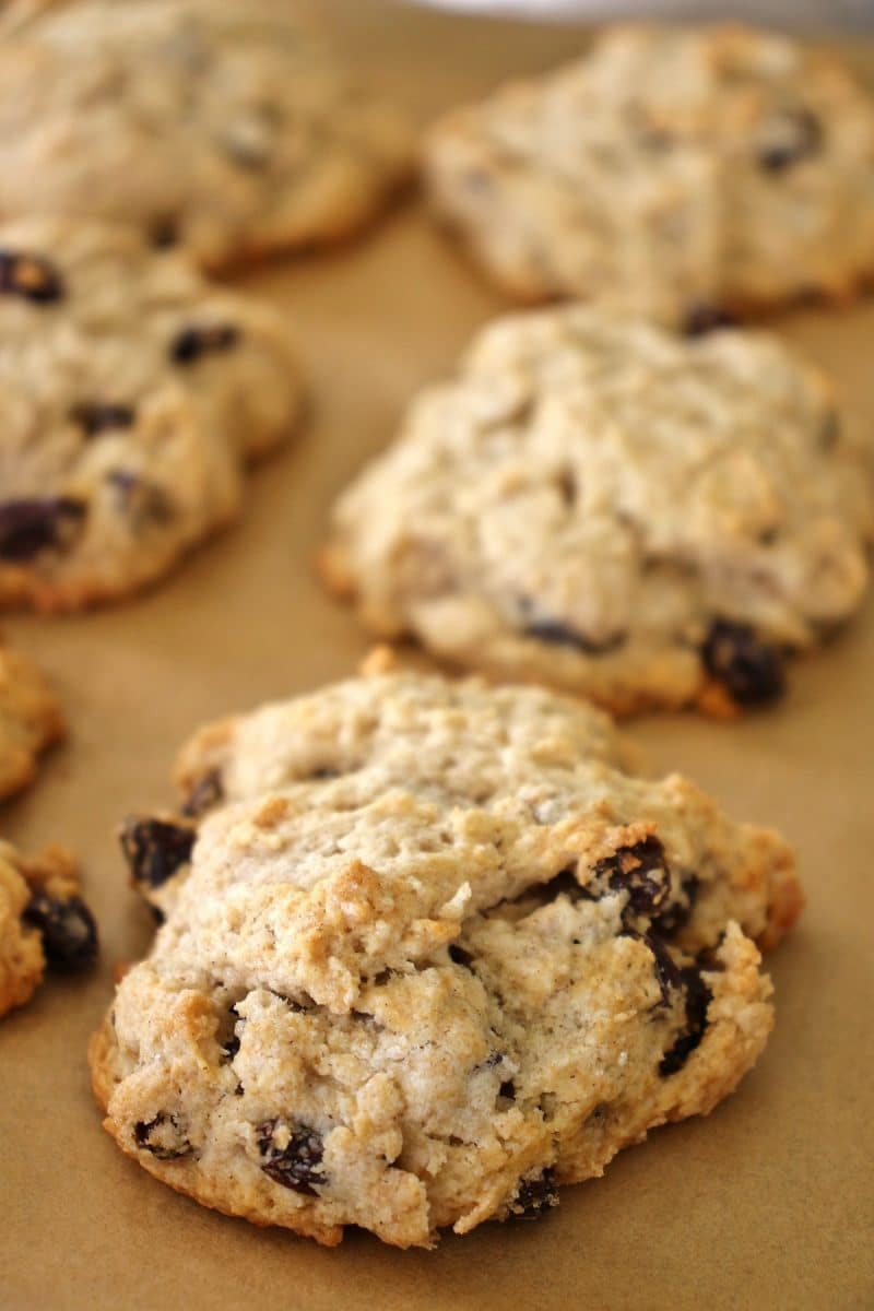 close up of baked British rock buns on a parchment paper-lined baking sheet