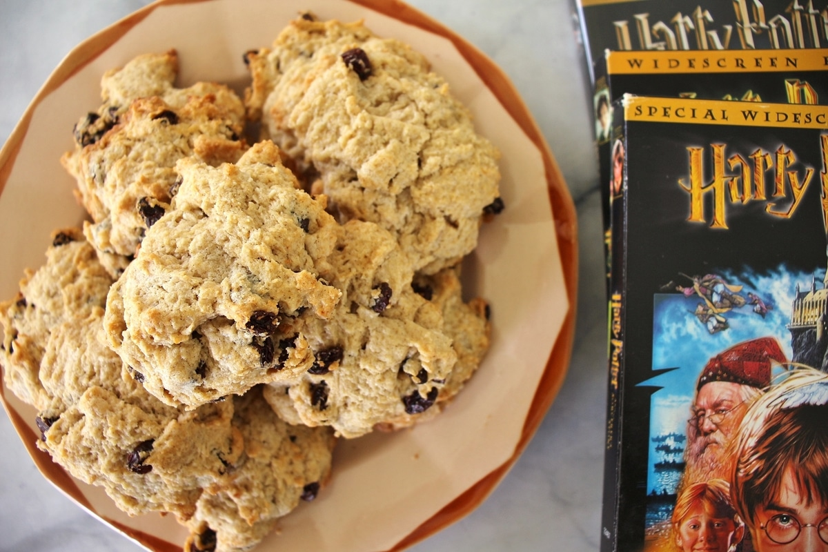 Antique plate topped with rock cakes, Harry Potter DVDs are arranged next to it