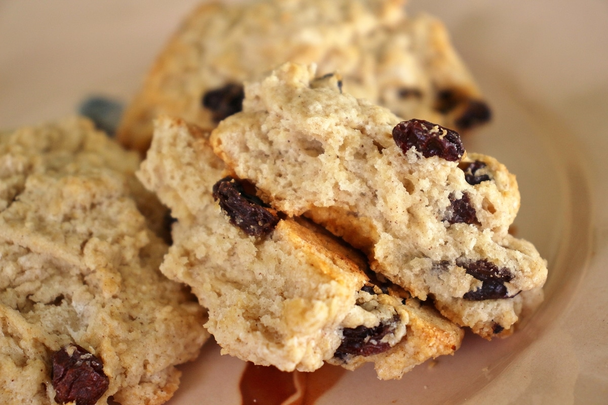 close up of a raisin filled rock cake broken in half to show the inside