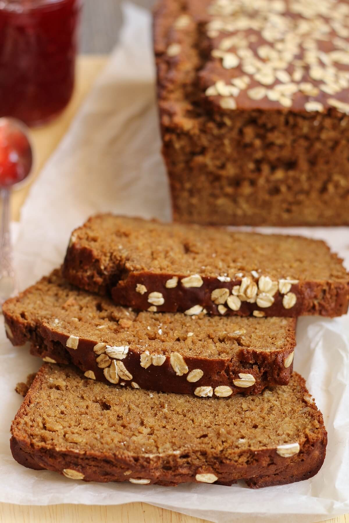 closeup of sliced Irish Guinness brown bread with oats on a wooden board