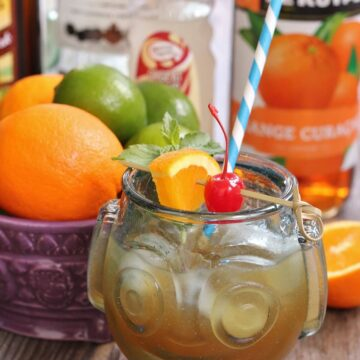 a HippopotoMai-Tai tiki drink in a glass shaped like a face