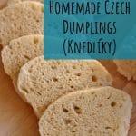sliced Czech dumplings fanned out on a wooden board
