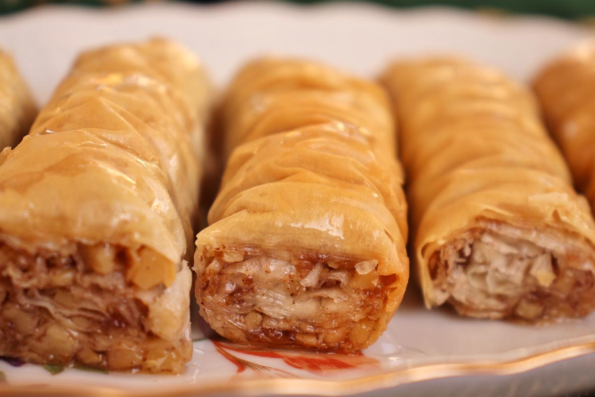 Closeup of rolled baklava showing off the chopped walnut filling.