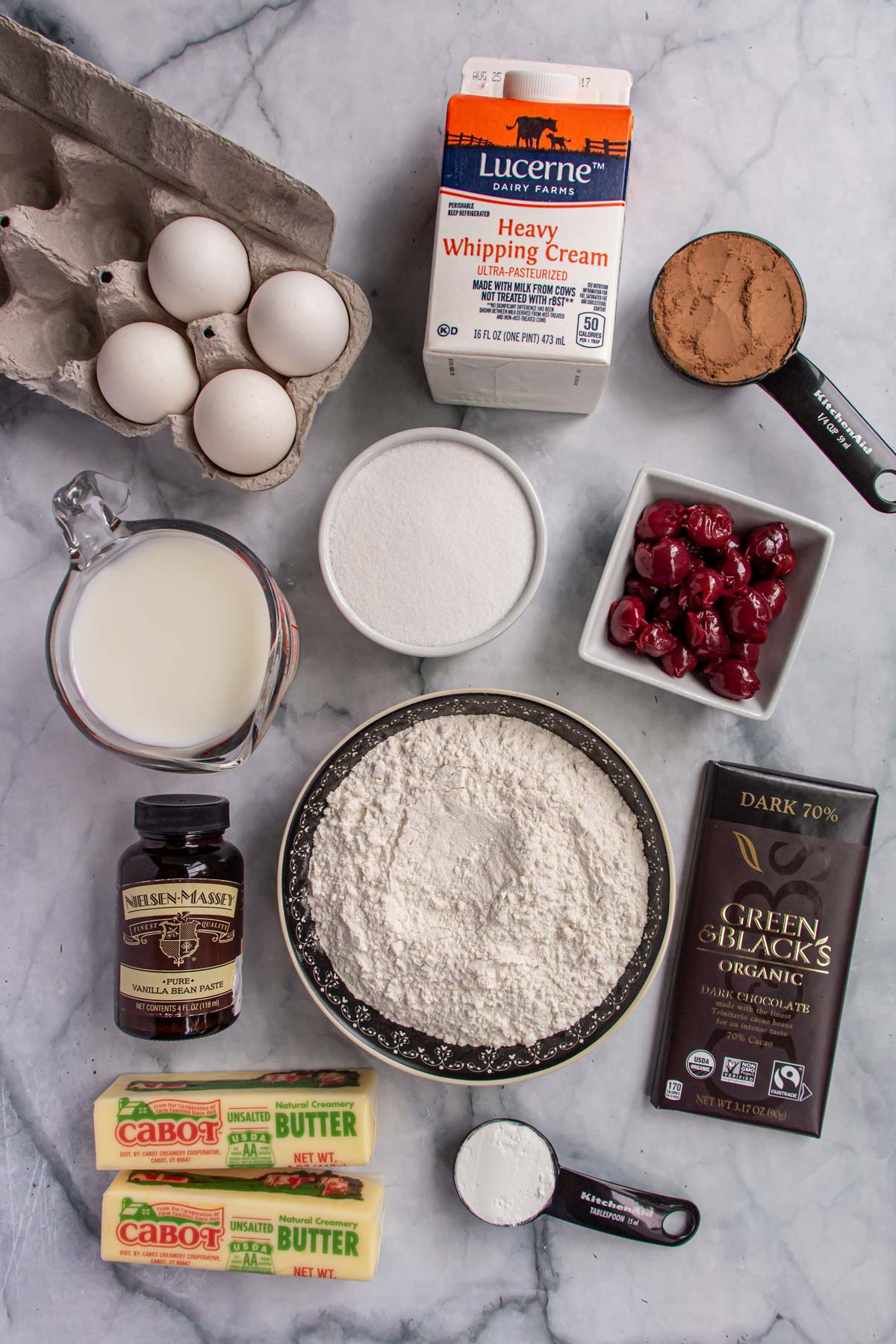 Ingredients for Danube wave cake on a white marble background.