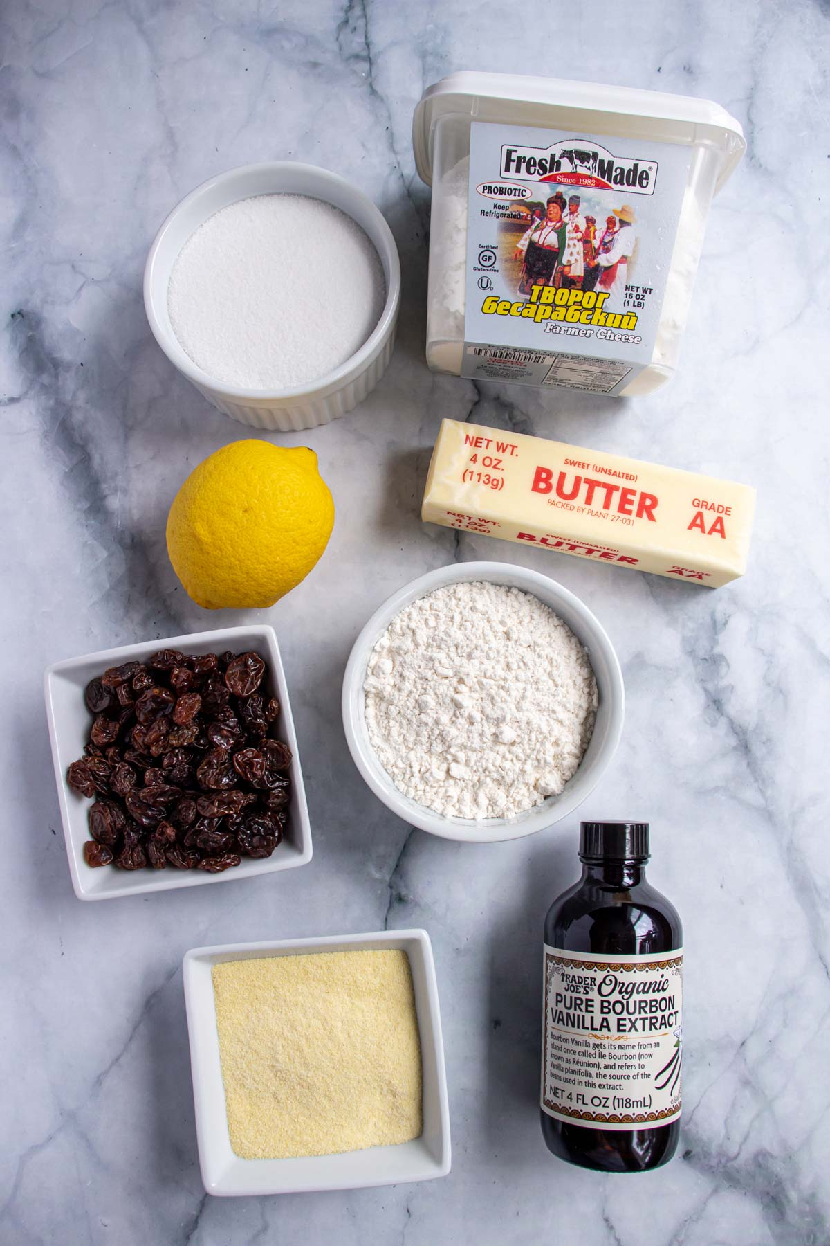 Ingredients for quark strudel on a white marble background.